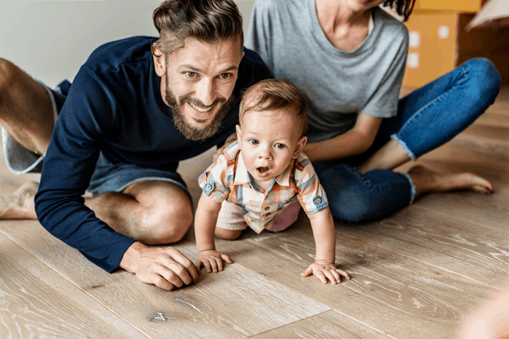 Movus Law family on wooden floor