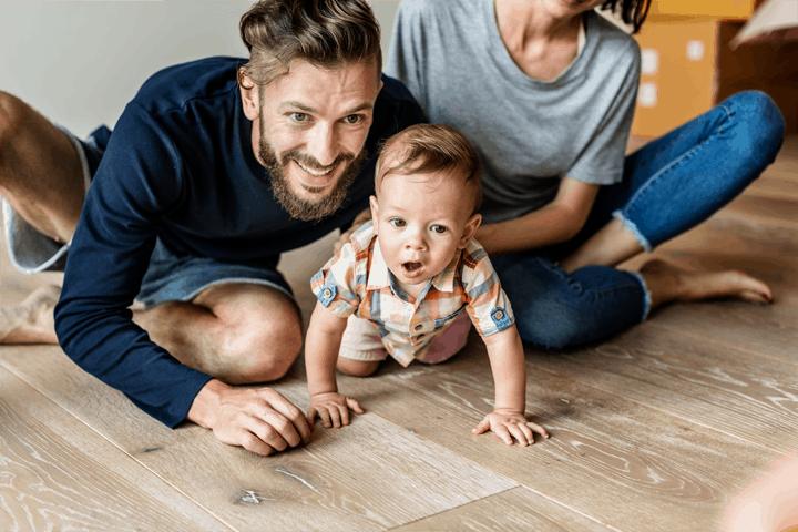 Movus Law family on wooden floor